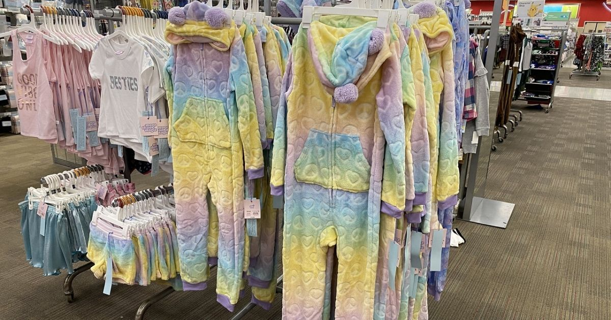 kids unicorn union suits hanging in store