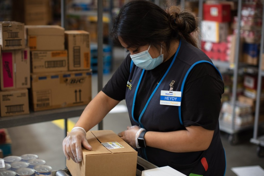 Walmart associate working in warehouse