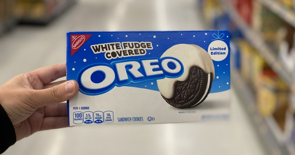 white chocolate oreos in hand in aisle