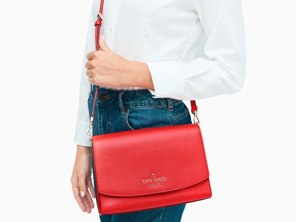 woman holding a red Kate Spade Carson Colorblock Carson Convertible Crossbody