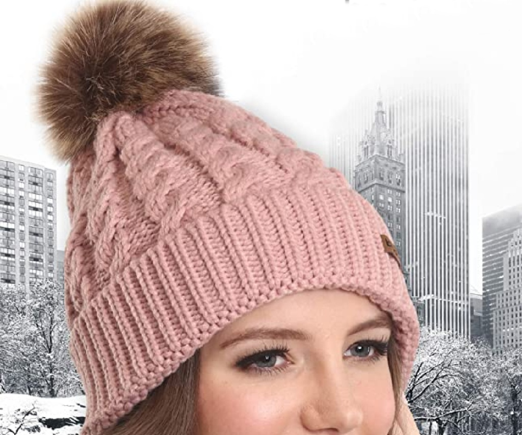 woman wearing pink beanie in city