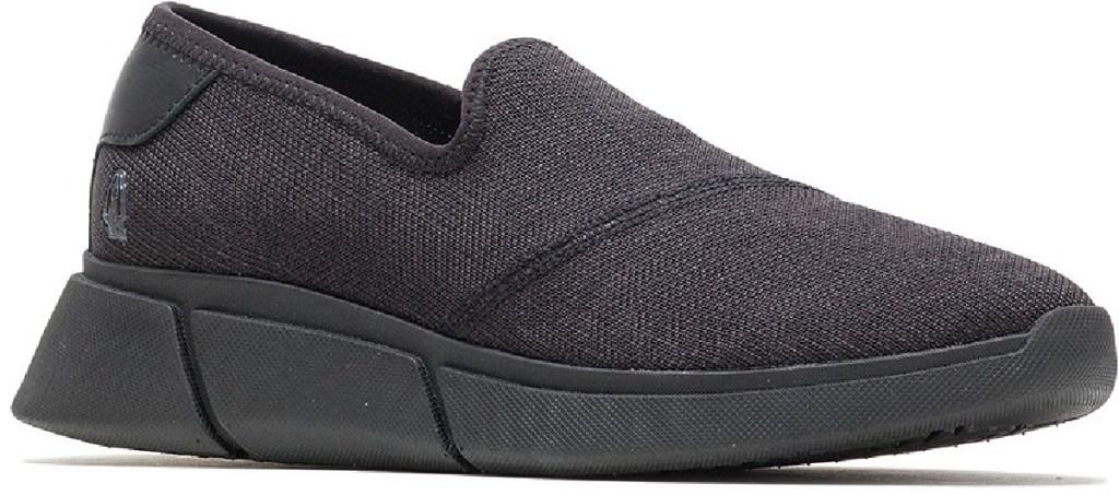 black slip on shoe on white background