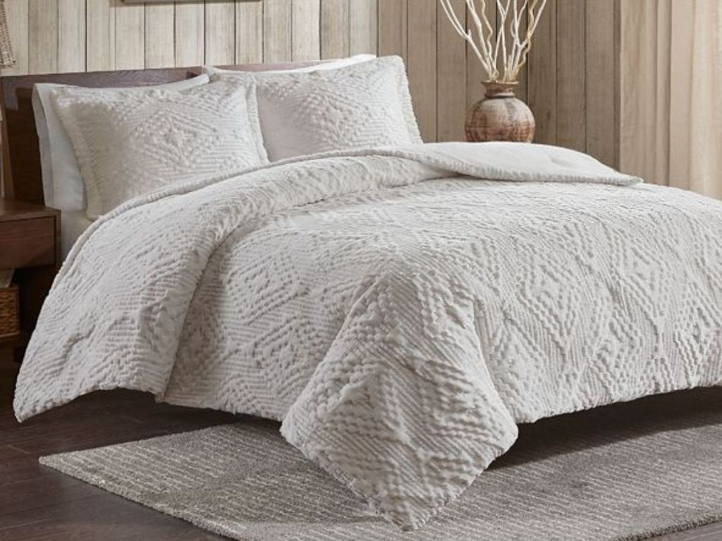 gray comforter on bed
