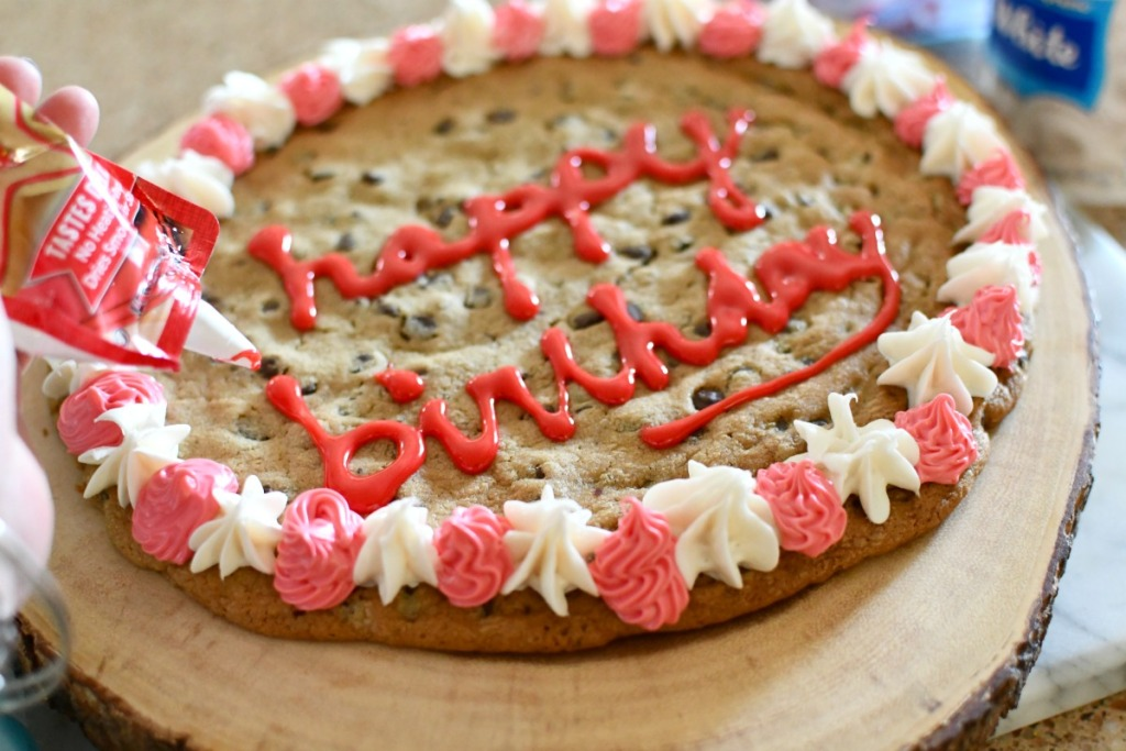 writing happy birthday on a cookie cake