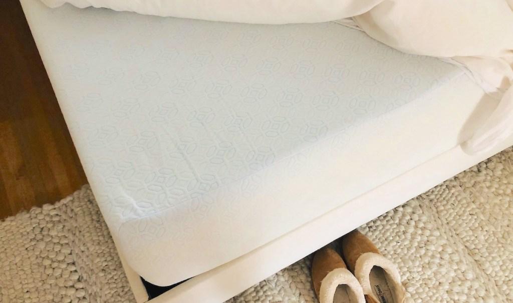 corner of white memory foam mattress