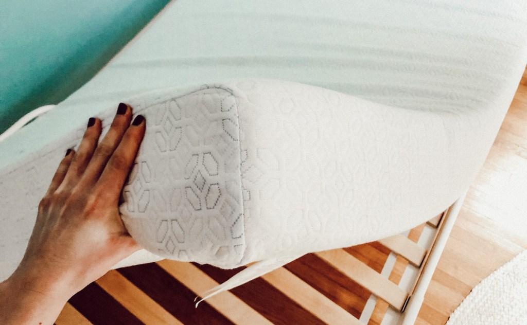 hand holding white memory foam mattress