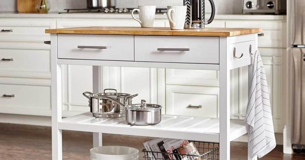 white kitchen cart with shelves and butcher block top