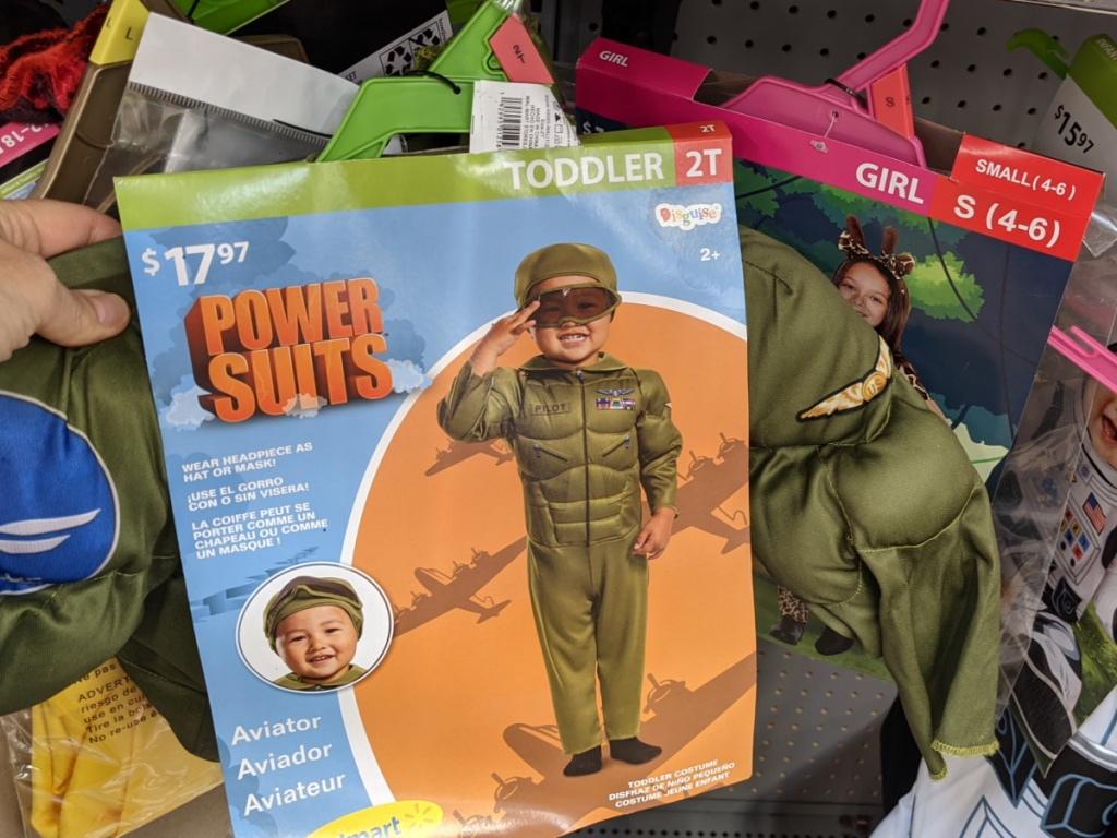 hand holding a toddler aviator costume at walmart