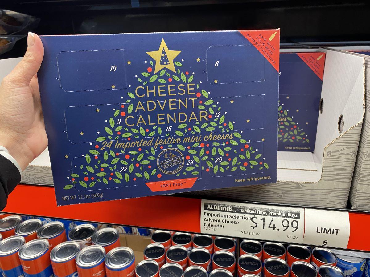 hand holding a cheese Advent Calendar