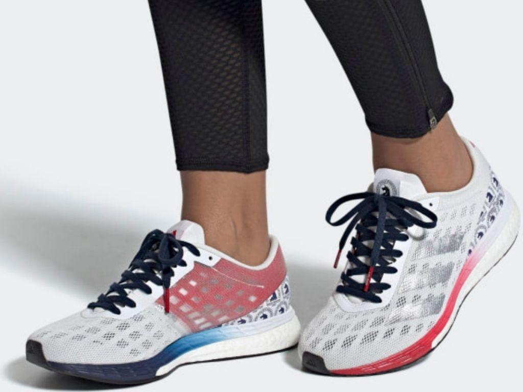 Woman wearing Adidas Adizero Marathon 9 Sneakers