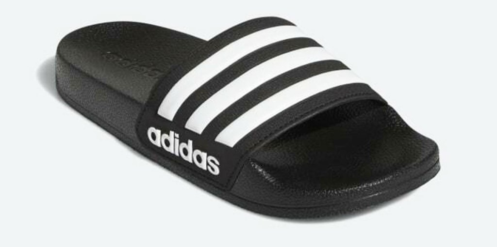 adidas black slide sandal with three white stripes across the top