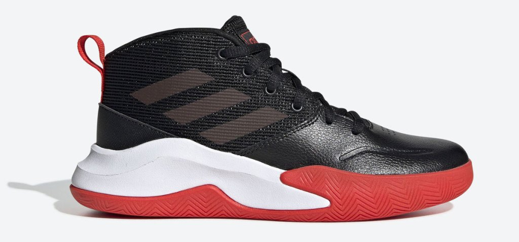 black kids adidas sneaker with white and red sole