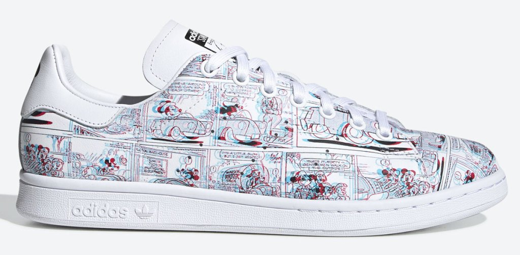 white pair of adiads sneakers with mickey mouse comic print