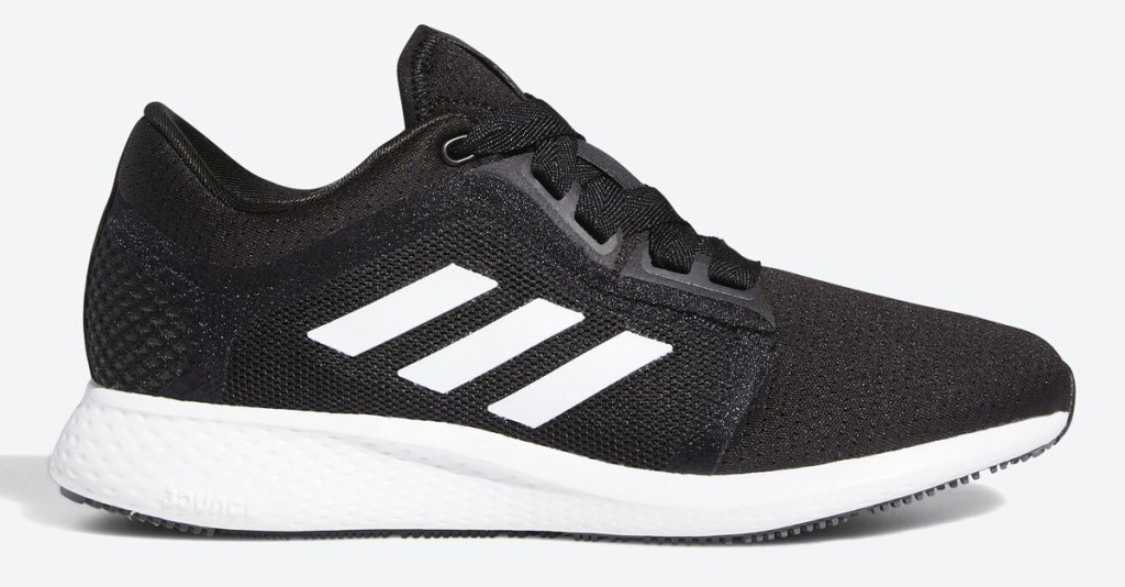 black pair of adidas running shoes with three white stripes and white foam sole