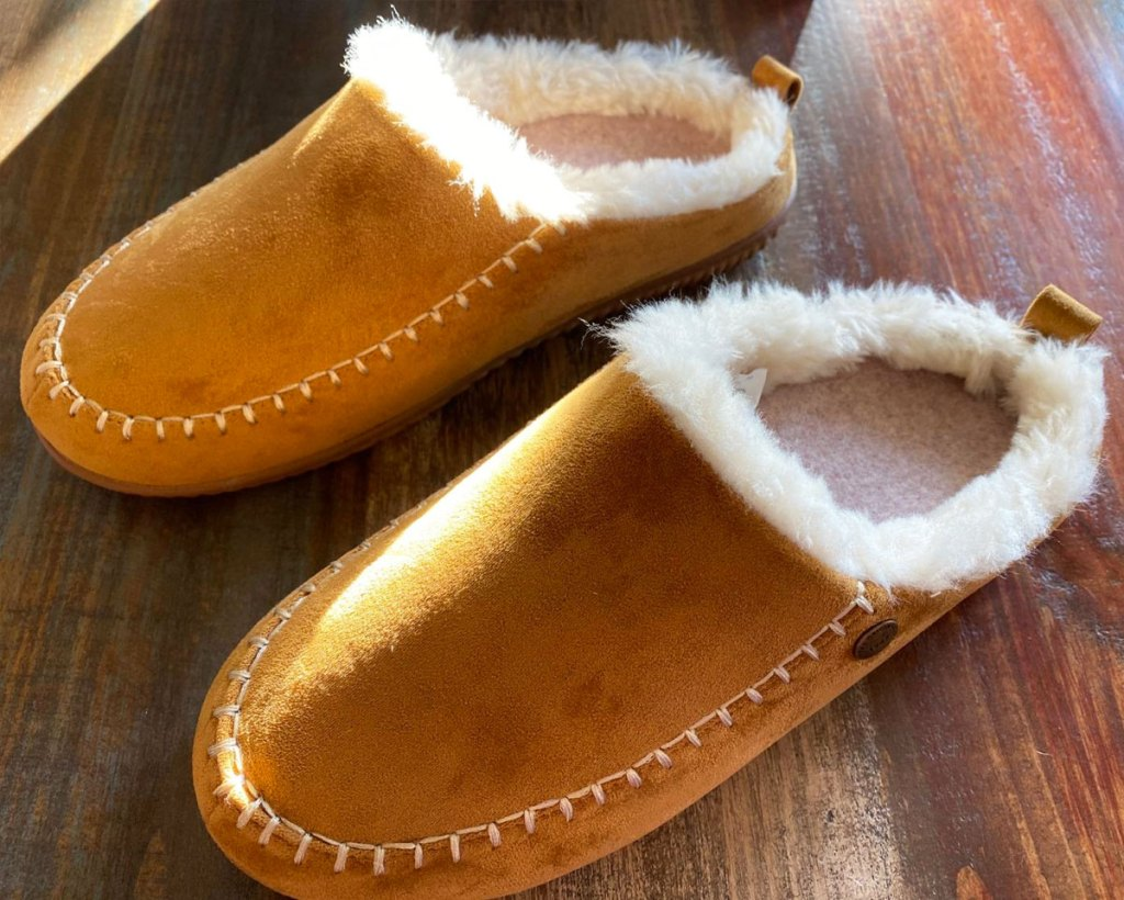 brown pair of leather women's clog slippers with sherpa interior