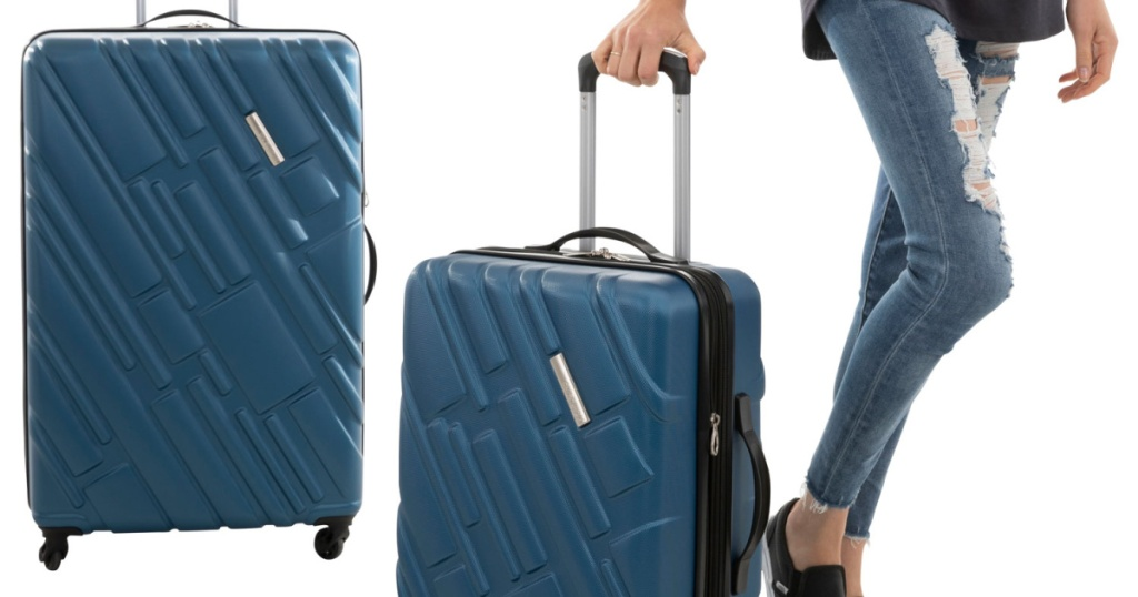 woman walking with blue suitcase and another blue suitcase