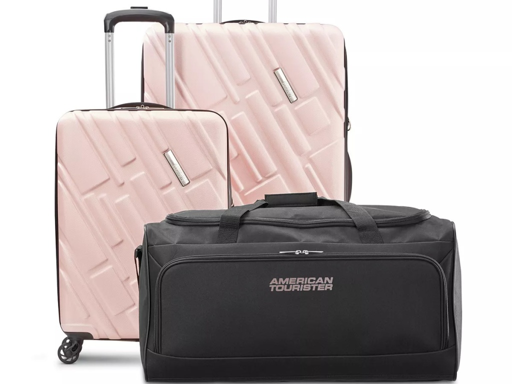 two pink suitcases and black duffel bag