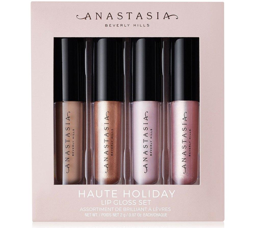 anastasia beverly hills lip gloss 4 bagian dalam kotak berwarna merah muda