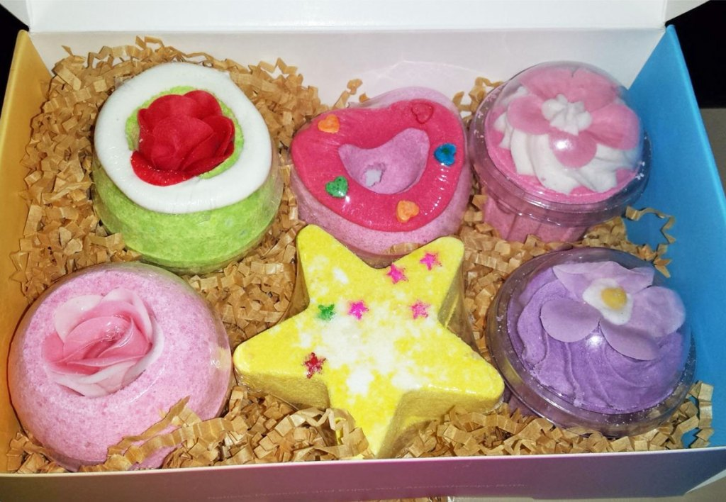 box with six bath bombs in various colors and shapes