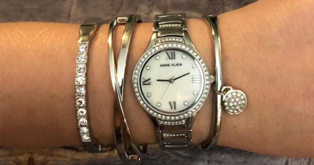 Woman wearing an Anne Klein watch and bangle bracelet set