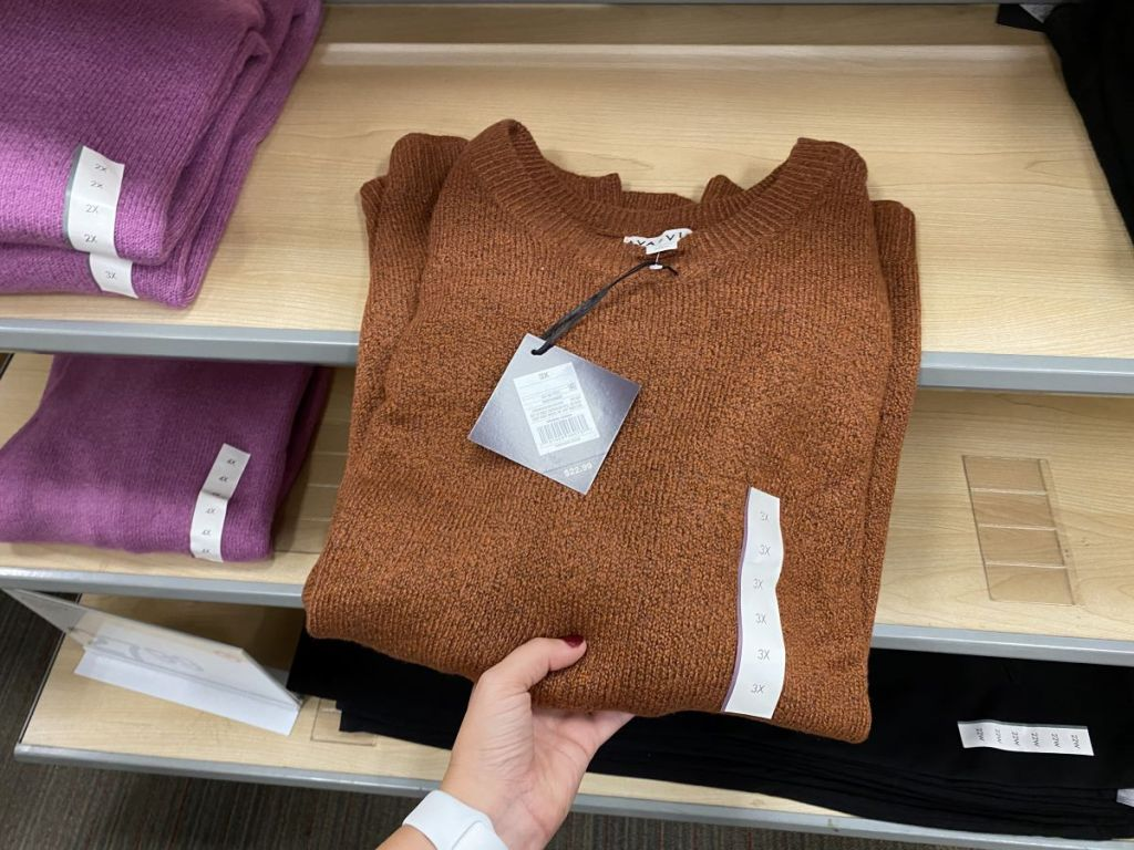 hand holding an Ava & Viv Sweater