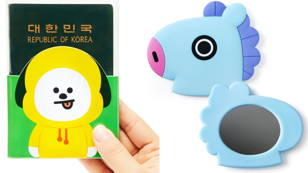 person holding up a passport with a yellow dog character cover and a blue horse shaped hand mirror