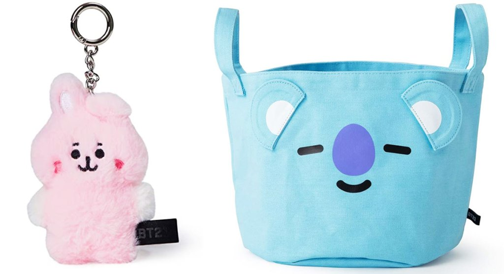 small pink plush character keychain and a blue fabric storage basket with a bear character's face