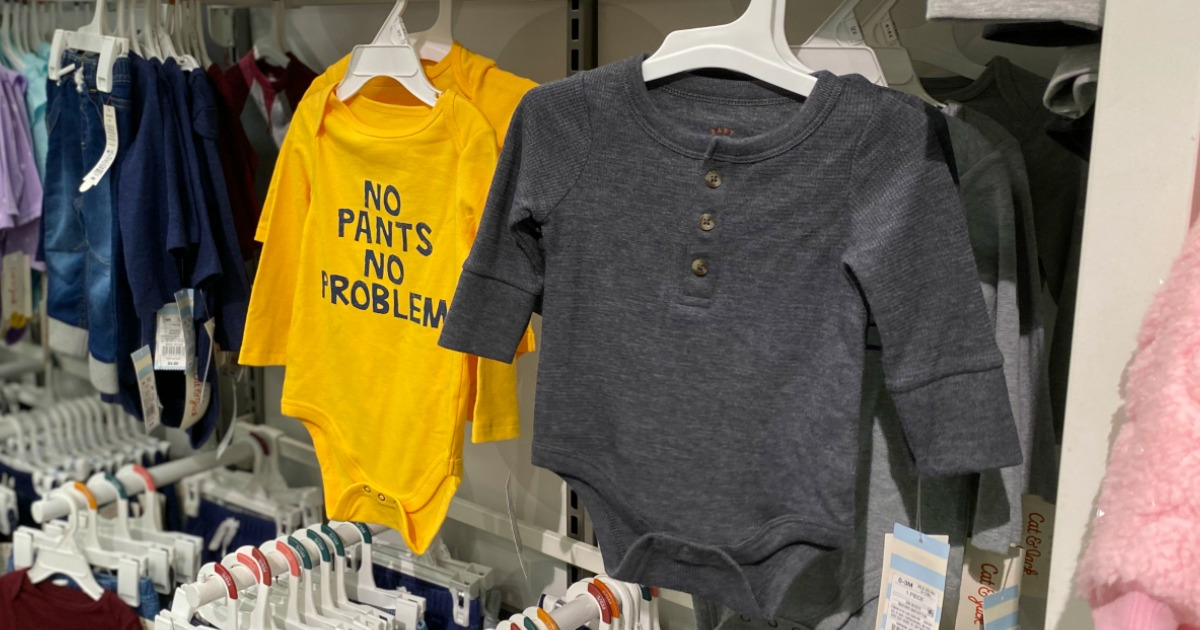 Baby bodysuits on display in-store on Target