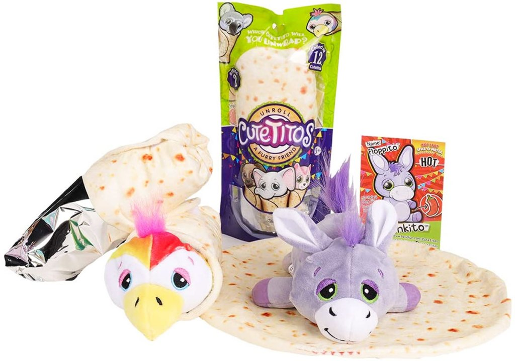 two plush animal toys laying on top of a tortilla wrap