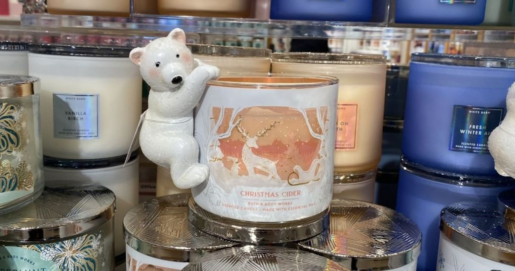 polar bear decoration hanging on a candle