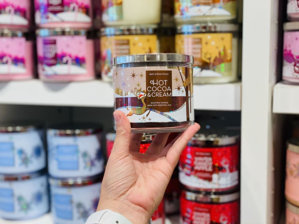 hand holding a Bath & Body Works Hot Cocoa Candle
