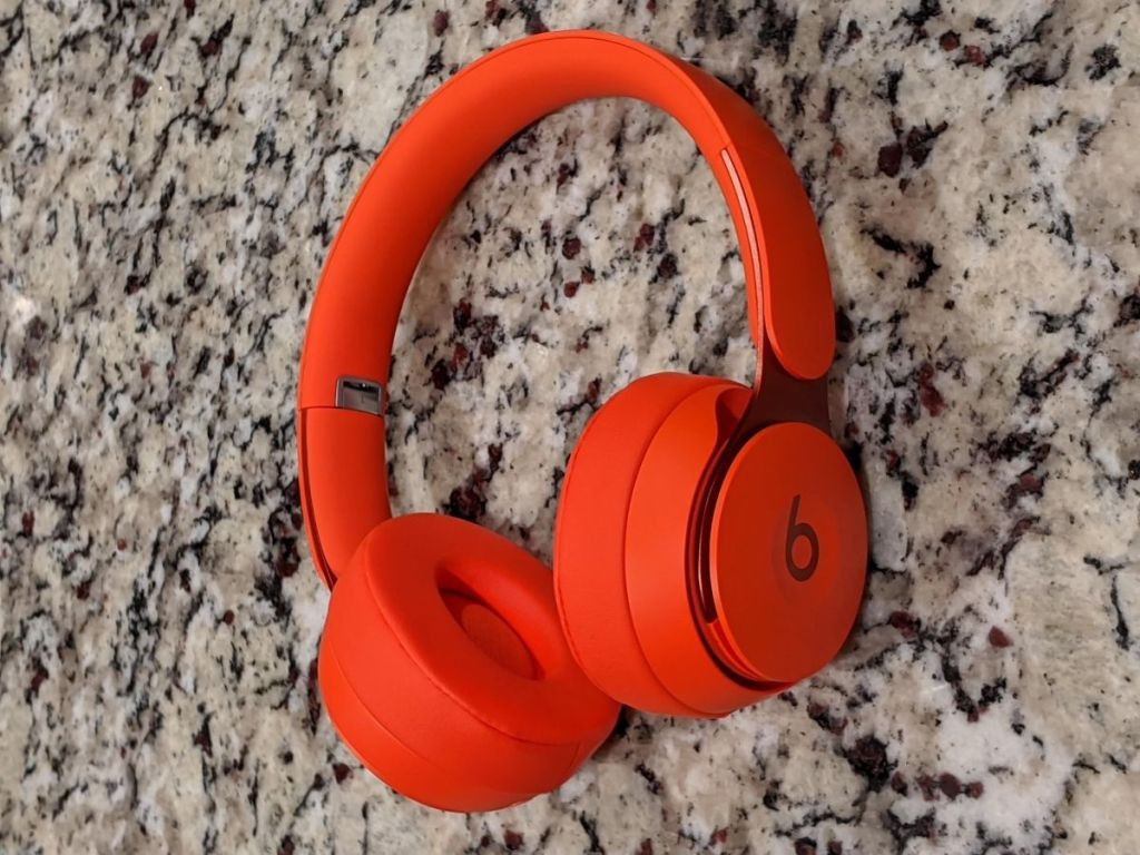red Beats headphones on marble surface