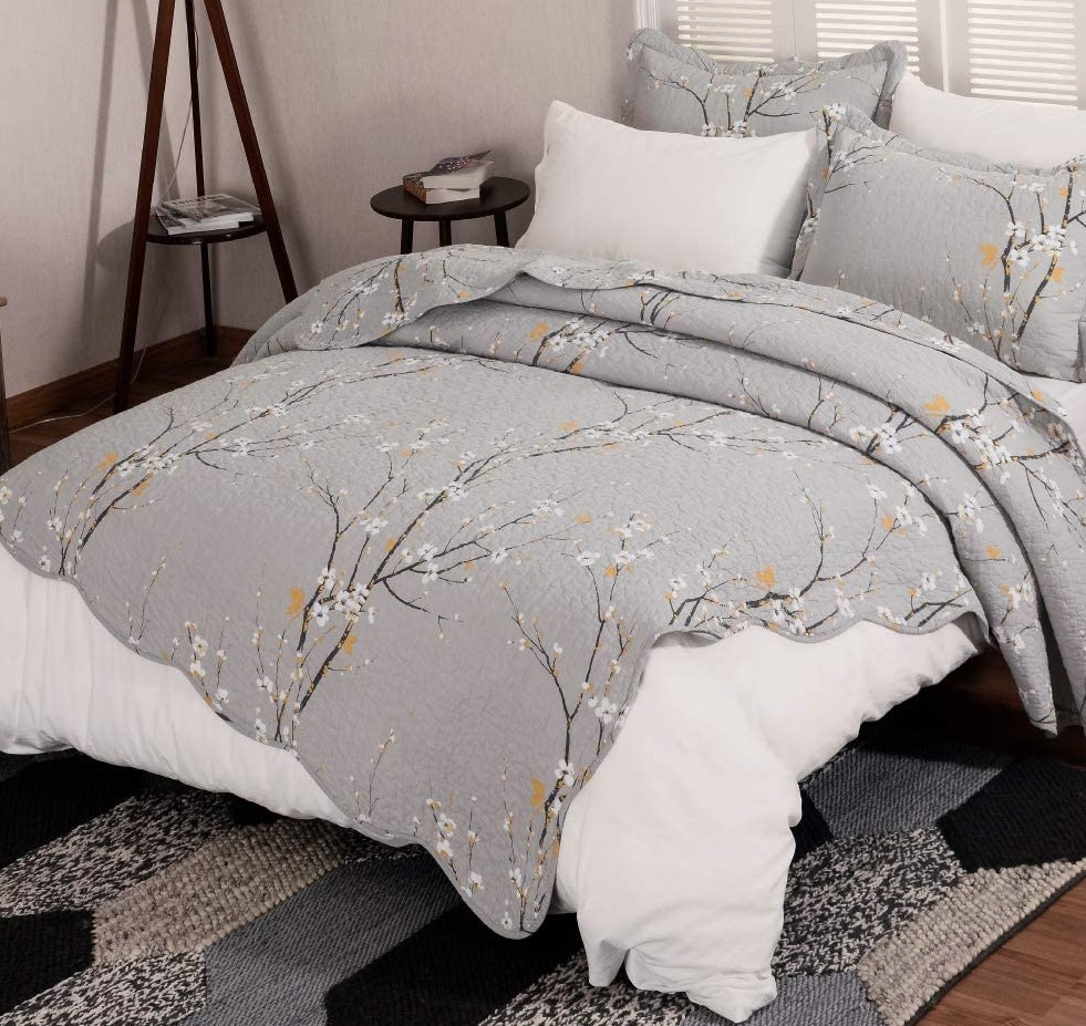 bed with a quilt and pillows on it