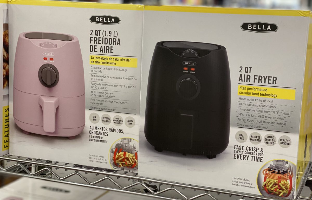 pink and black air fryers in boxes on store shelf