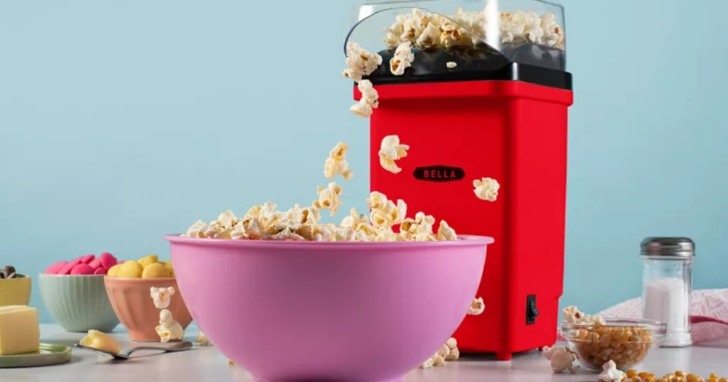 bella popcorn maker next to a bowl full of popcorn maker