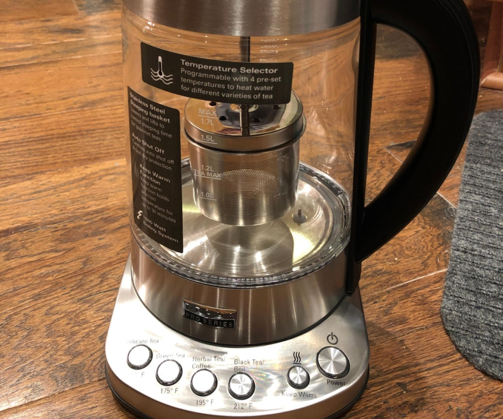 stainless steel electric kettle on wood table