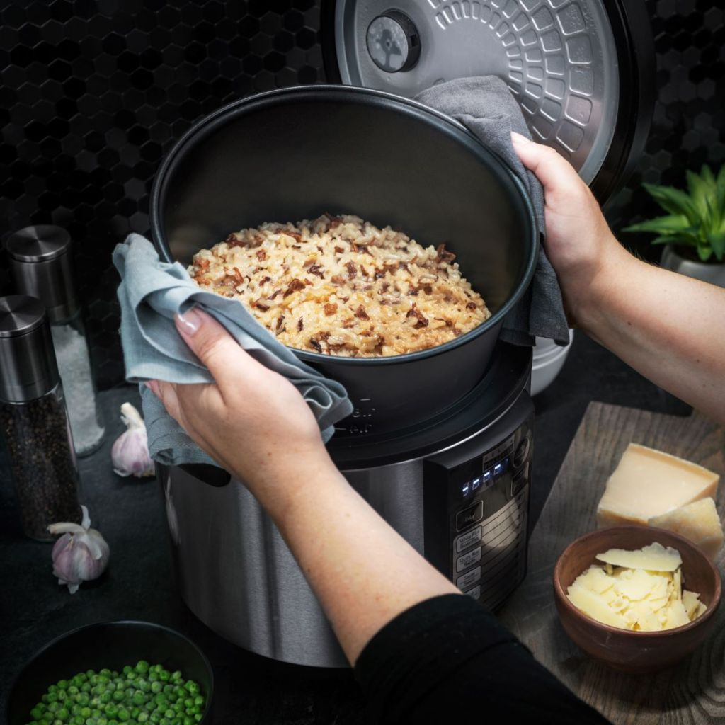 person taking insert out of rice cooker