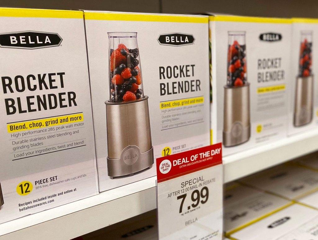 Bella brand rocket blender sets on shelf with $7.99 sale price sign at Macy's
