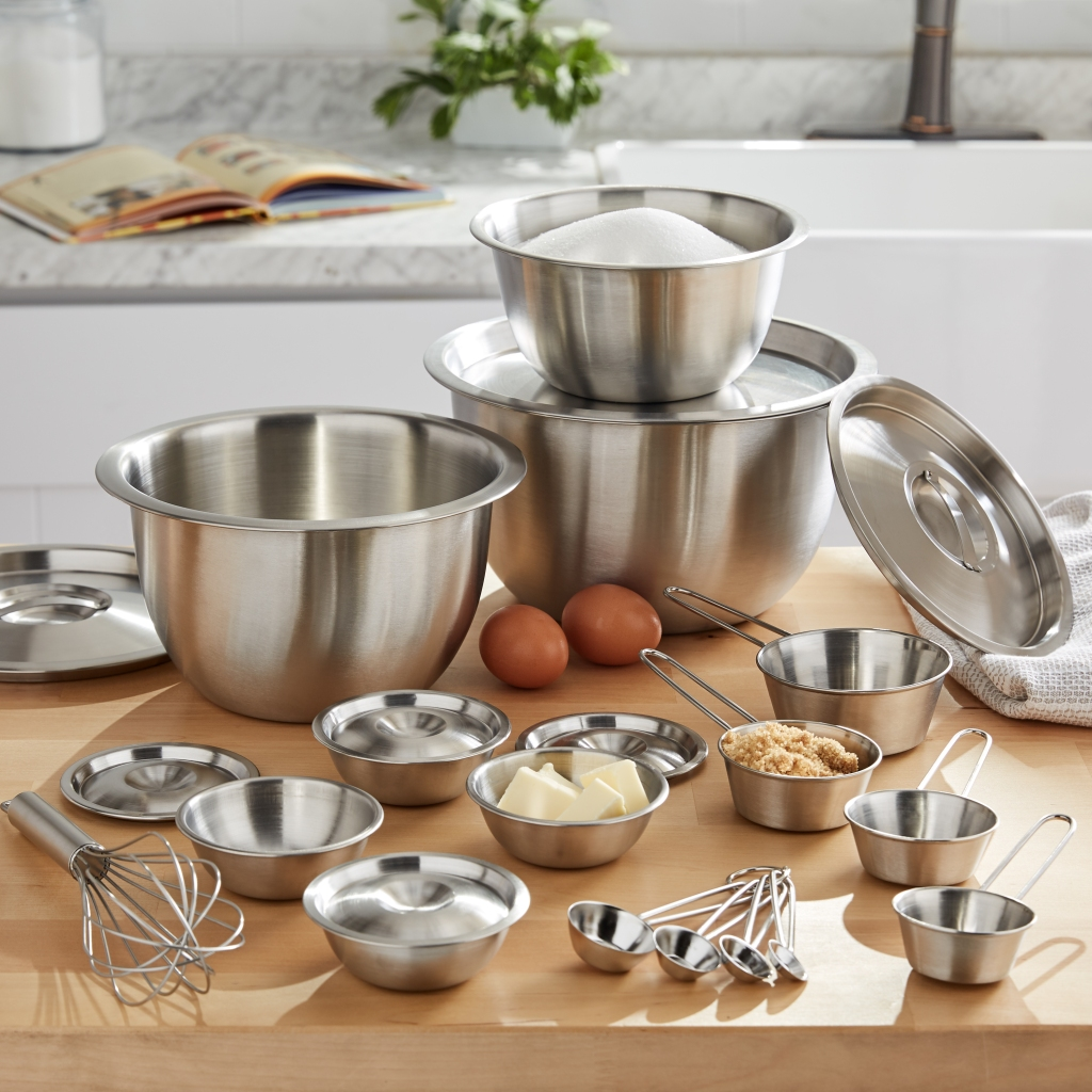 stainless steel mixing bowls on a table