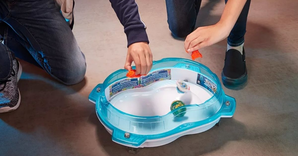 kids playing with Beyblade toys