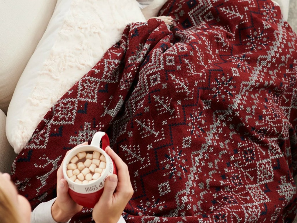 Holiday printed heated blanket on a woman's lap