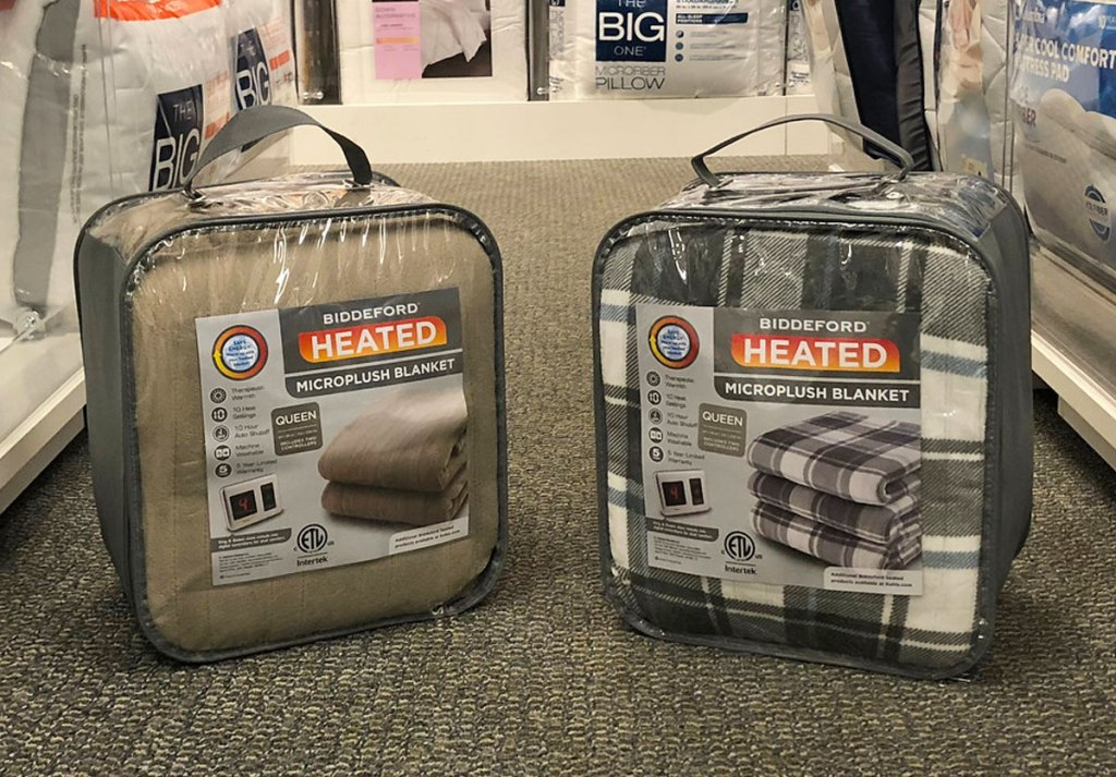 two biddeford heated blankets in clear packages on floor at kohl's