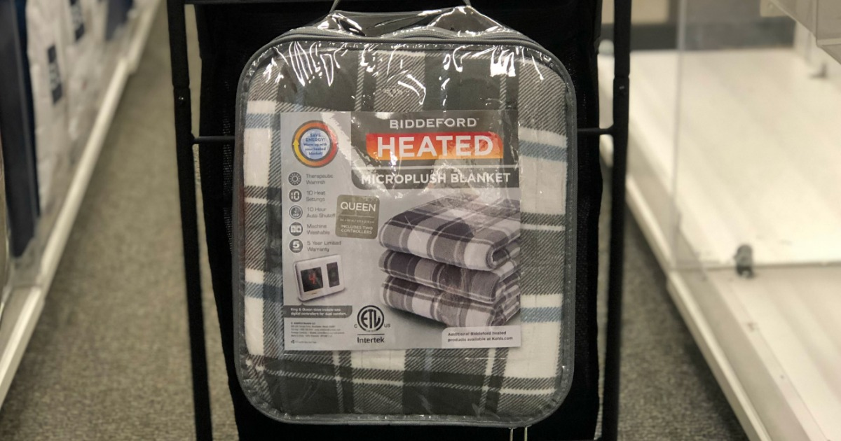 Plaid heated blanket in package on back of Kohl's shopping cart