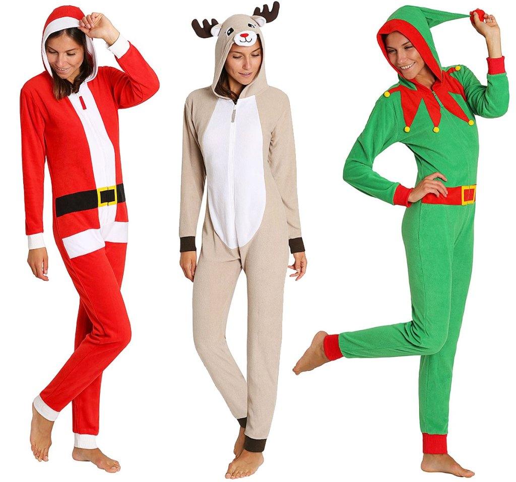 three women in christmas themed one piece pajamas in santa, reindeer, and elf styles