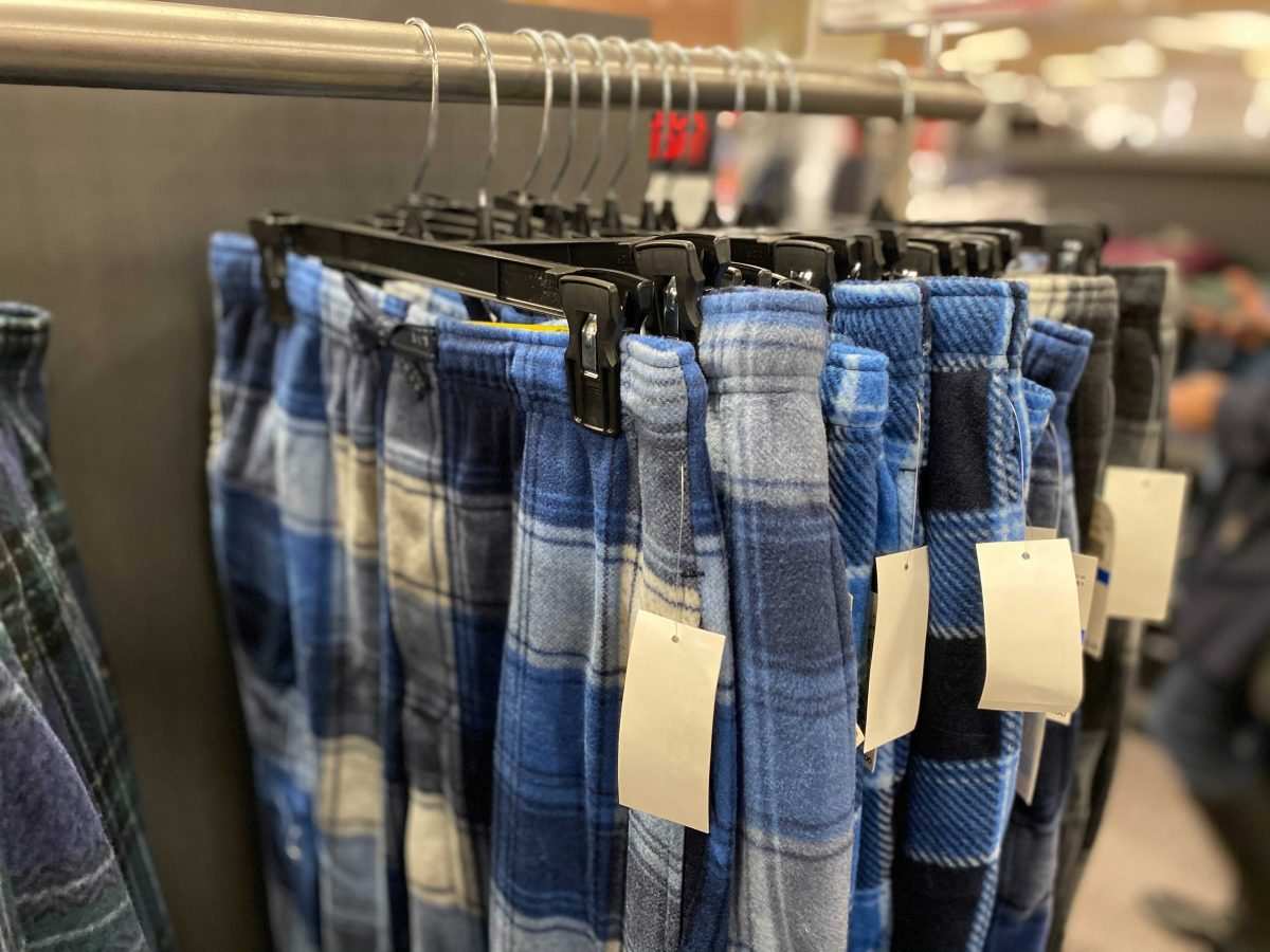 Blue Perry Ellis Pajama Pants hanging in store