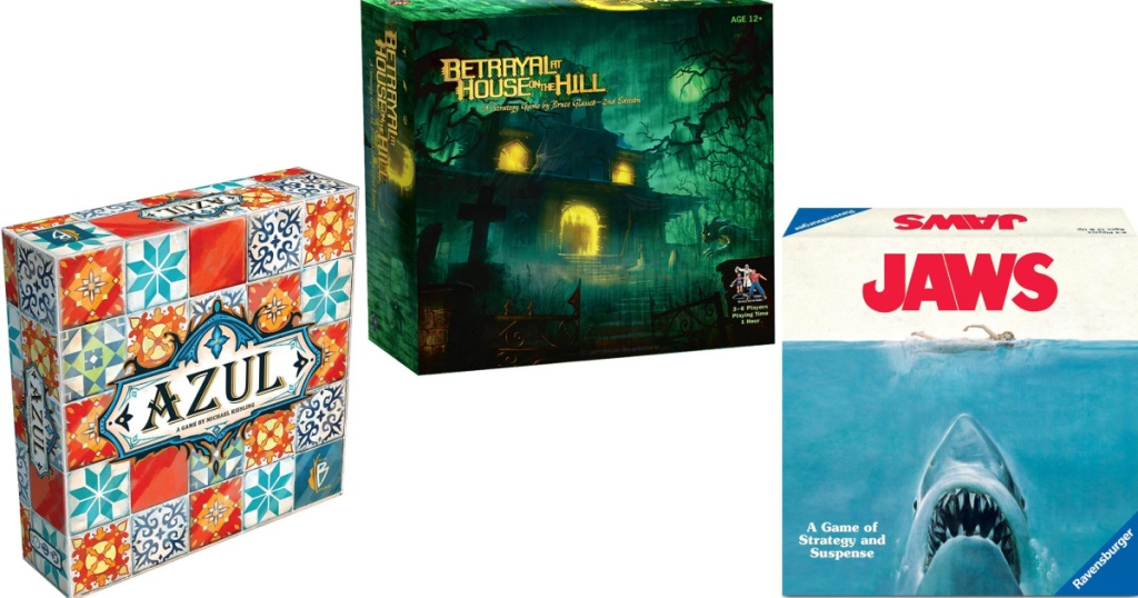 three board game boxes