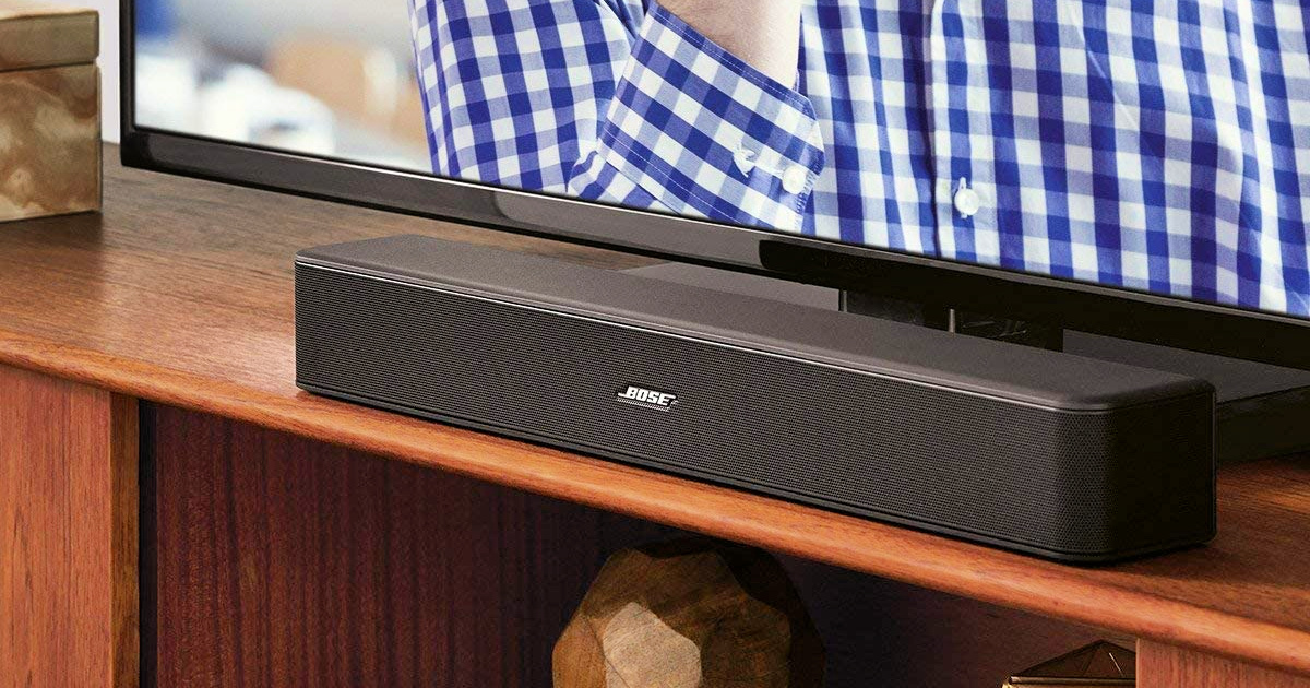 Bose Solo 5 TV Sound System on entertainment stand near TV