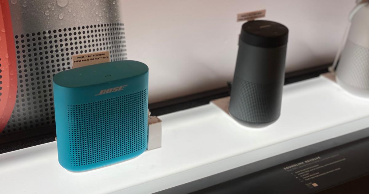 two speakers on shelf