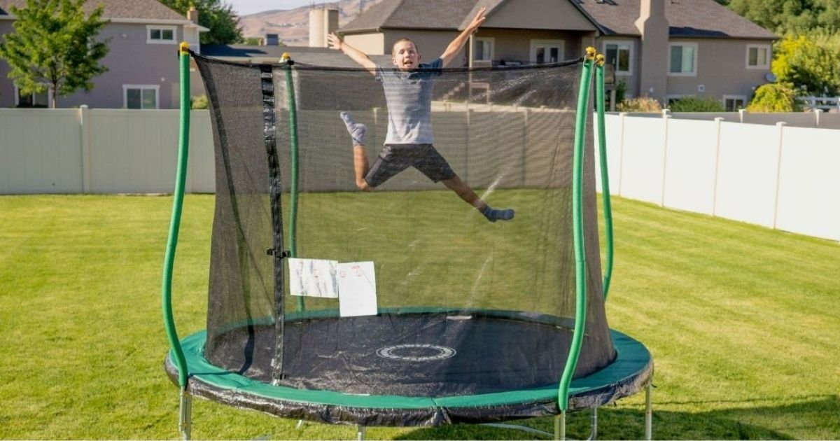 boy jumping on Bounce Pro 10' Trampoline with Flashlight Zone