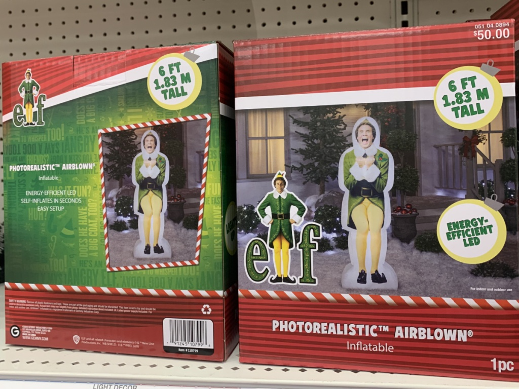 two Buddy the Elf inflatables on store shelf